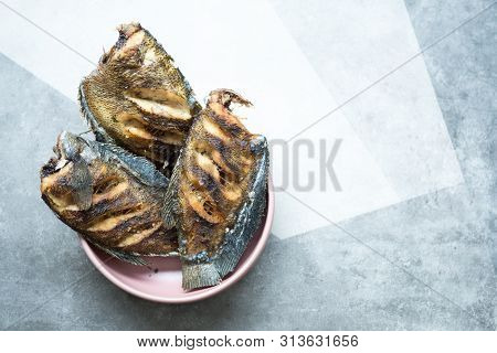 Trichogaster Pectoralis Fried Salted Fish On Pink Bowl. Thai Food