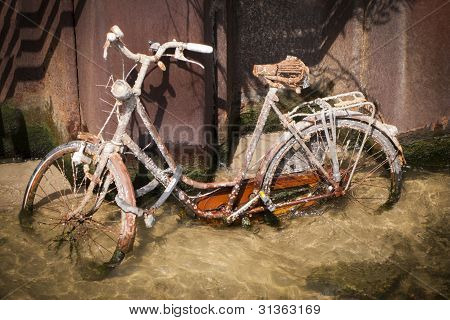 Drowned rusty bicycle