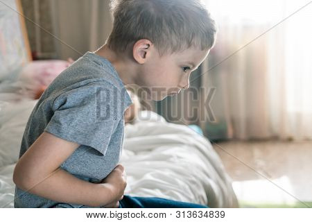 Abdominal Pain In A Preschool Child. Poisoning In Children. The Boy Holds His Hands To The Abdominal
