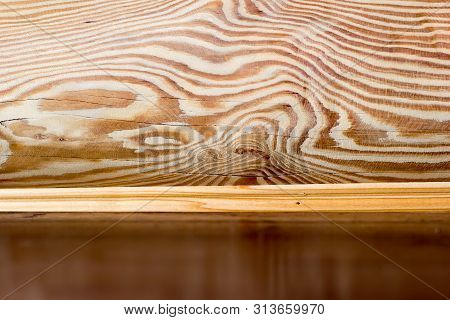 Interior Of Log Wooden House. Close-up Wooden Wall From Round Logs. Copy Space. Place For Custom Tex