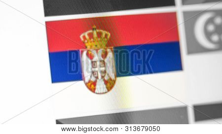 Serbia National Flag Of Country. Serbia Flag On The Display, A Digital Moire Effect. News Of Geograp