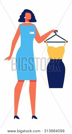 Woman Stylist In Blue Dress With Dress In Hand On Hanger On White Background. Stylist Picks Clothes.
