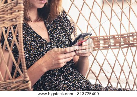Woman Looking At Cell Phone. Woman Looking At Cell Phone Message. Woman Typing Message On Cell Phone