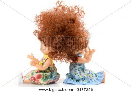 Two Dolls Sit