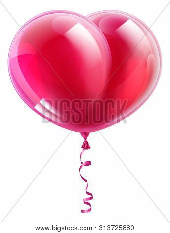 A Pink Or Red Heart Shaped Valentines Day Balloon