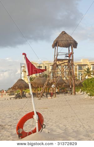Lifeguard Tower And Dangerous Tide Warning