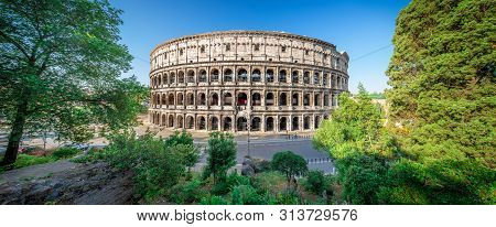 Colosseum At Sunrise, Rome, Italy, Europe. Rome Ancient Arena Of Gladiator Fights. Rome Colosseum Is