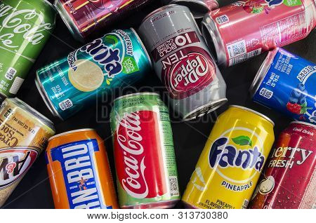 Omsk, Russia - July 14, 2019: Close-up Soda. Different Manufacturers. Coca Cola, Fanta, 7up, Iron Br