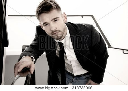 Handsome Man Wearing Tie And Jacket Climbing Stairs