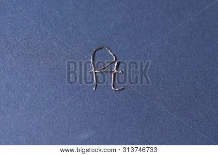 Metal Platinum, A Piece Of Metal. The Letter Of Platinum From Platinum Wire.