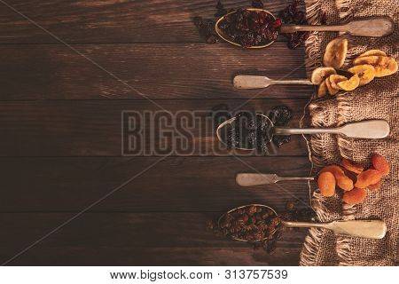 Dried Fruits Arranged On A Spoon, Fabric And An Old Table. Composition In The Old Style With A View