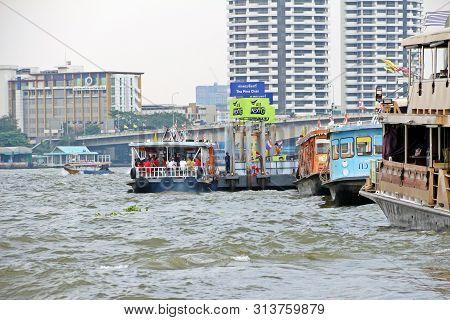 Bangkok, Thailand - 29 December 2018: Fully Ferry Boat Parked At Tha Phra Chan Dock In Choa Praya Ri