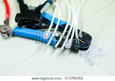 Crimper And Wire Cutter Isolated On A White Background. Twisting Cable Tool Twisted Pair Ethernet Ut