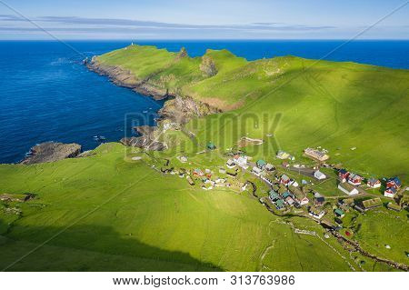 Aerial View Of Village At Mykines Island In Faroe Islands, North Atlantic Ocean. Photo Made By Drone