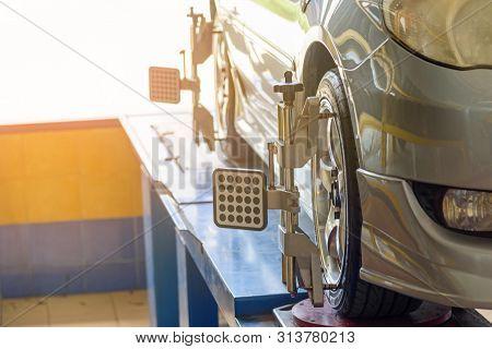 Car Wheel Alignment In Tire Garage Service