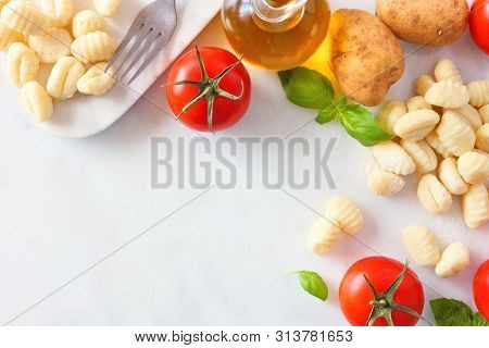 Gnocchi Meal Ingredients Including Fresh Gnocchi, Tomatoes, Olive Oil, Potatoes And Basil. Above Vie