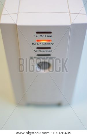 Uninterruptible power supply, operating in a mode On battery. Front view. poster