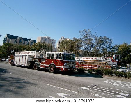 San Francisco, California - October 29, 2011: Two Sffd Red Firetrucks Parked On The Street.
