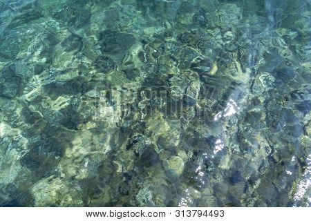Transparent Sea Water Top View. View Of Calm Sea Water. Top View Of A Clean Ocean Water Near A Coast