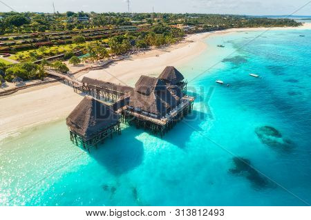 Aerial View Of Beautiful Hotel On The Water In Ocean At Sunset In Summer. Zanzibar, Africa. Top View