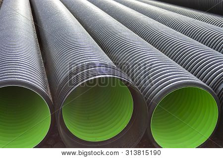 Large corrugated PVC pipes for drainage. Corrugated water pipes of large diameter prepared for laying. poster