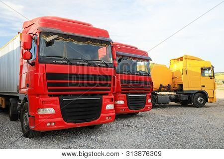 Different Bright Trucks Parked Outdoors. Modern Transport