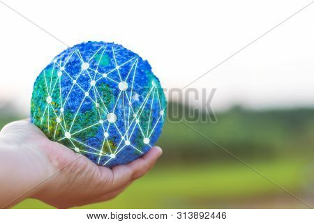 Hand Holding Simulated World With Global Structure Networking Social Network Diagram Stay Outdoor Wi