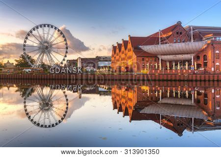 Gdansk, Poland - July 25, 2019: Beautiful scenery of Gdansk city over Motlawa river, Poland. Gdansk is the historical capital of Polish Pomerania with beautiful architecture.