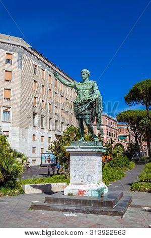 Naples, Italy - June, 2018: Ancient Statue Of Julius Caesar In A Green Park In Naples Near The Seasi