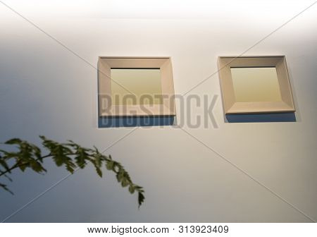 The Blank Wooden Picture Frame On The Wall