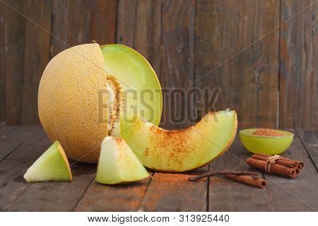 Cantaloupe Melon And Melon Slices With Cinnemon And Brown Sugar On Wooden Background. Refreshing Sli