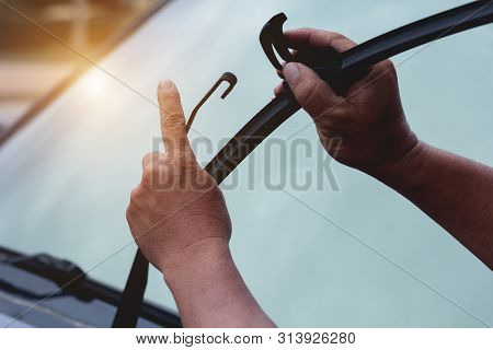 Mechanic Replace Windshield Wipers On Car. Replacing Wiper Blades Change Cars Wiper Blades. Technici