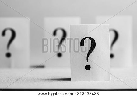 Four Question Mark Cards Stood On White Background.