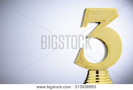 3rd Placed Runner Up Metallic Gold Trophy With A 3d Number 3 On White With Copy Space