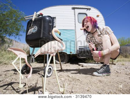 Girl In Front Of A Trailer Eating A Hotdog