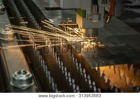 The Fiber Laser Cutting Machine Cutting The Sheet Metal Plate With The Sparking Light. The Sheet Met