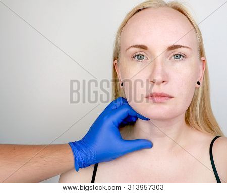 A cosmetologist prepares the patient for surgery: contour plastics of the neck, mesotherapy or botulinum therapy. Wrinkles and creases in the neck, rings of Venus poster