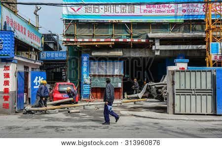 Nanning, China - Nov 1, 2015. Workers Working At Construction Site In Nanning, China. Nanning Is The