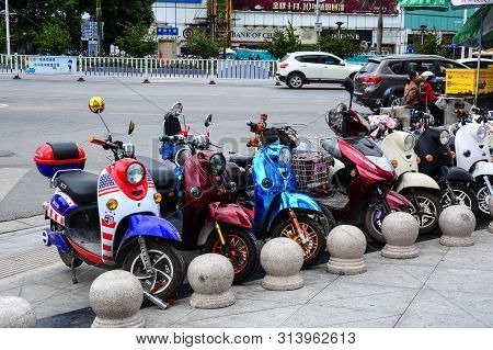 Nanning, China - Nov 1, 2015. Motorbikes Parking On Street In Nanning, China. Nanning Is The Capital