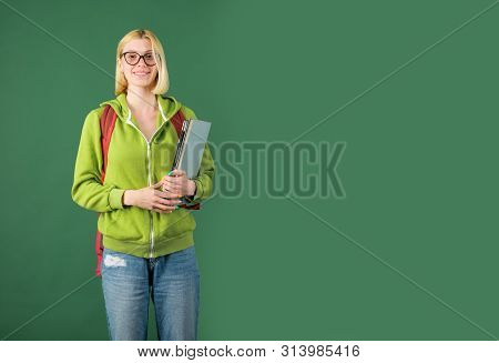 Funny Female Young Teacher In The Classroom. Portrait Of A Female Student In University. Young Teach