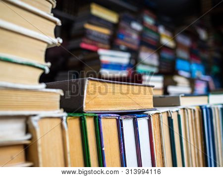 Pile Of Old Books. Books For Fans Of Analog Reading. Stack Of Books On The Bookshelf. The Day Of The