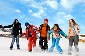 Group of sport teens different ethnicity jumping winter outdors at mountain Tien Shan. One boy and four girls. (series Sport Extreme Mountains and Teenagers) poster