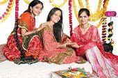 Festival celebrations in India by applying mehendi / henna. poster
