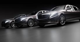 Luxurious cars, limousines in garage with lights turned on. Generic and brandless yet contemporary and elegant look. 3D illustration