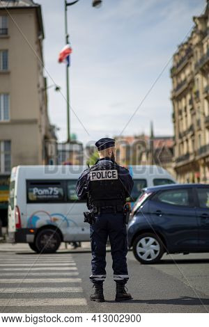 Paris, France - May 11, 2017: A Traffic Cop Regulating The Traffic In The City Centre.