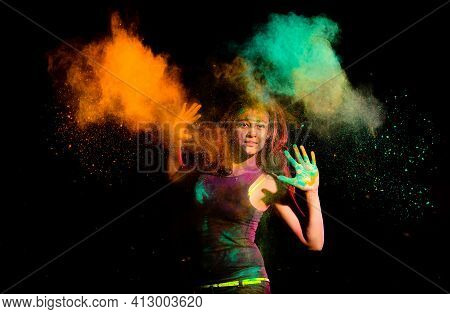 Beautiful Young Woman With Dry Colorful Powder Holi Exploding Around Her. Holi Festival Color