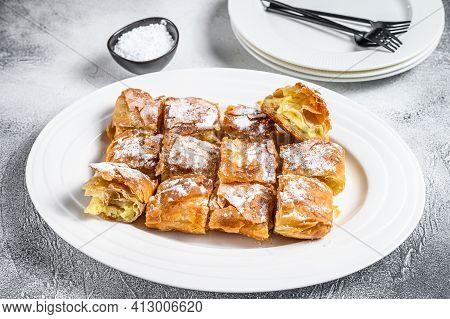 Bougatsa Pie Pastry With Semolina Custard Cream On A Plate. White Background. Top View