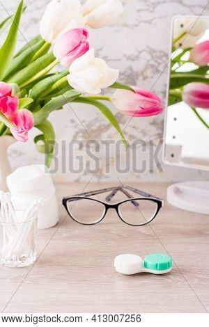 Low Vision And The Choice Between Glasses And Lenses. Container For Lenses In Front Of Glasses, Hygi