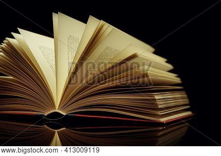Opoen Book Against A Perfect Black Background