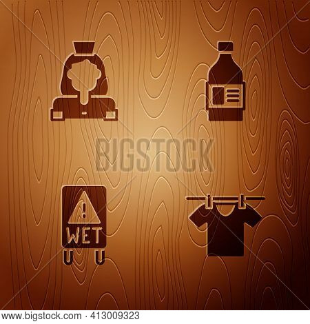 Set Drying Clothes, Cleaning Lady Service, Wet Floor And Bottle For Cleaning Agent On Wooden Backgro